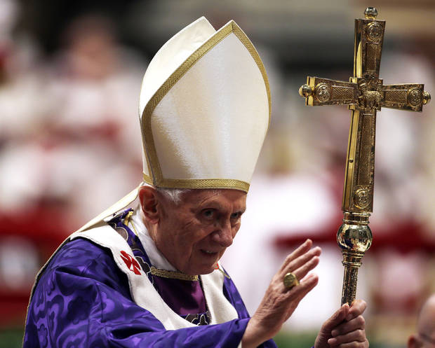 "Pope Benedict XVI greets the faithful at the end of the Ash Wednesday mass in St. Peter's Basilica at the Vatican, Wednesday, Feb. 13, 2013.  Ash Wednesday marks the beginning of Lent, a solemn period of 40 days of prayer and self-denial leading up to Easter. Pope Benedict XVI told thousands of faithful Wednesday that he was resigning for ""the good of the church"", an extraordinary scene of a pope explaining himself to his flock that unfolded in his first appearance since dropping the bombshell announcement. (AP Photo/Gregorio Borgia)"