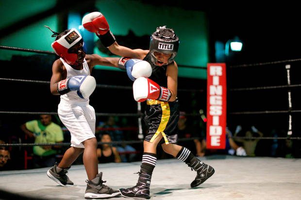 Nine-year-old Chris Barba, of Edmond, at right, fights Roderick Tisdale, 10, of Pawhuska, during the pair's first fight at The Underground Arena in Oklahoma City, Saturday, June 15, 2013. Photo by Bryan Terry, The Oklahoman