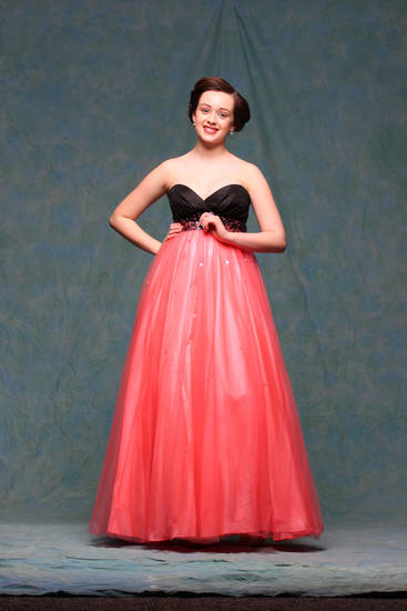 Model  Keely wears a coral and black strapless gown with sweetheart neckline from Jump Apparel by Wendye, $219. Photo by Steve Webb, for The Oklahoman. <strong></strong>