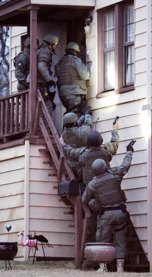 Agents with the Oklahoma Bureau of Narcotics and Dangerous Drugs Control and local law enforcement agencies prepare to enter an apartment at 2409 N Drexel in Oklahoma City. Photo by Paul B. Southerland, The Oklahoman <strong>PAUL B. SOUTHERLAND - PAUL B. SOUTHERLAND</strong>