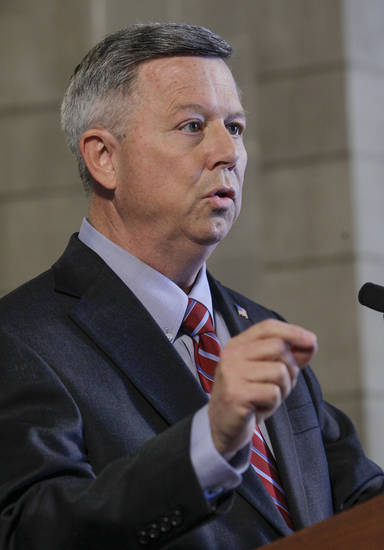 Nebraska Gov. Dave Heineman announces in Lincoln, Neb., Thursday, Nov. 15, 2012 that he has decided that Nebraska will choose the federal health insurance exchange program. (AP Photo/Nati Harnik)