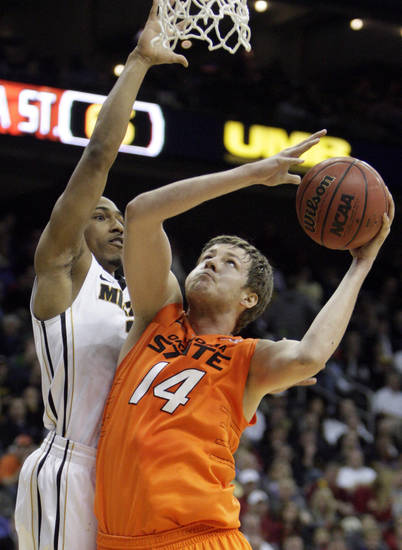 Oklahoma's Marek Soucek (14) shoots over Missouri's Matt Pressey (3) during the Big 12 tournament men's basketball game between the Oklahoma State Cowboys and Missouri Tigers the Sprint Center, Thursday, March 8, 2012. Photo by Sarah Phipps, The Oklahoman