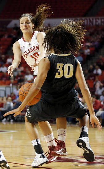 OU&#039;s Morgan Hook (10) runs into Vanderbilt&#039;s Elan Brown (30) and is called for a charge in the first half during a women&#039;s college basketball game between the University of Oklahoma Sooners and the Vanderbilt Commodores at Lloyd Noble Center in Norman, Okla., Sunday, Dec. 16, 2012. Photo by Nate Billings, The Oklahoman