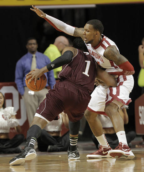 Oklahoma&#039;s Romero Osby (24) guards Louisiana&#039;s Jayon James (1) during a men&#039;s college basketball game between the University of Oklahoma and the University of Louisiana-Monroe at the Loyd Noble Center in Norman, Okla., Sunday, Nov. 11, 2012.  Photo by Garett Fisbeck, The Oklahoman