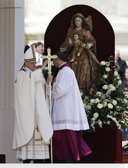 Pope Francis blesses the faithful in St. Peter's Square during his inauguration Mass at the Vatican, Tuesday, March 19, 2013. (AP Photo/Gregorio Borgia)