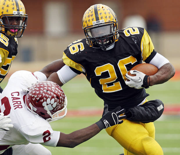 Lawton MacArthur's Darius Graham (26)  runs past Brian Carr (2) of Ardmore on the way to a touchdown during a high school football playoff Class 5A semifinal game between Lawton MacArthur and Ardmore in Yukon., Saturday, Nov. 26, 2011. Photo by Nate Billings, The Oklahoman