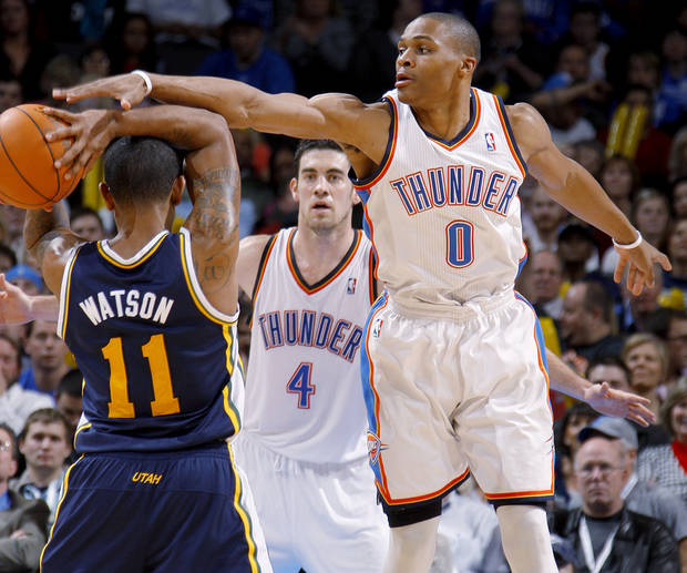 Oklahoma City's Russell Westbrook (0) defends Utah's Earl Watson (11) during an NBA game between the Oklahoma City Thunder and the Utah Jazz at Chesapeake Energy Arena in Oklahoma CIty, Tuesday, Feb. 14, 2012. Photo by Bryan Terry, The Oklahoman