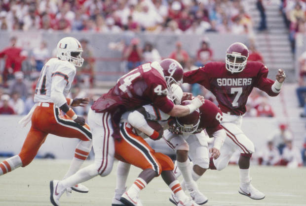Former Sooners defenders Brian Bosworth (44) and Randy Hughes are each on the College Football Hall of Fame ballot. Photo was published in The Daily Oklahoman 8-24-1986.