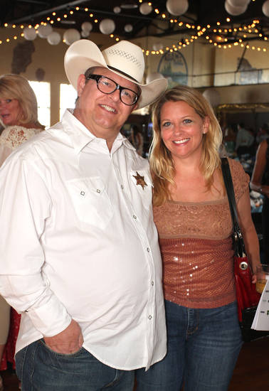 Richard Hill and Jeffri-Lynn Dyer attend the Cowboy & Couture fundraiser for Peace Through Business which is implemented by IEEW.