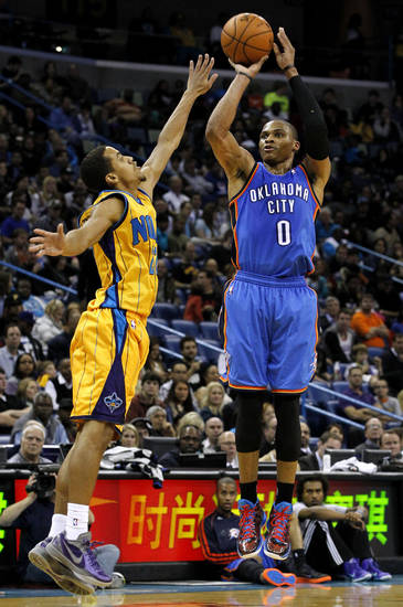 Oklahoma City Thunder point guard Russell Westbrook (0) shoots the ball over New Orleans Hornets point guard Brian Roberts (22) during the second half of an NBA basketball game in New Orleans, Friday, Nov. 16, 2012. The Thunder won 110-95. (AP Photo/Jonathan Bachman) ORG XMIT: LAJB119