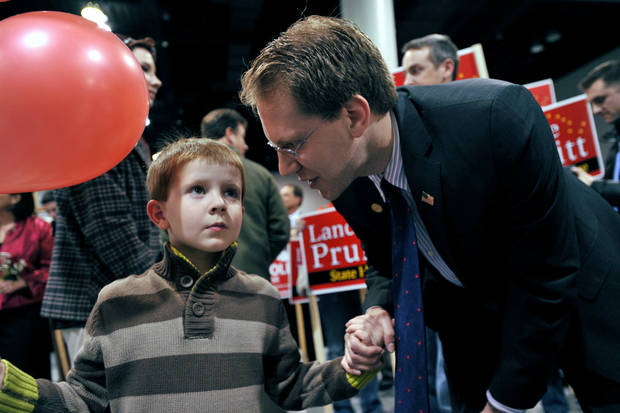 Incumbent Alaska State Representative Lance Pruitt talks with his son Jacob, 6, at election central Tuesday, Nov. 6, 2012 in Anchorage, Alaska. (AP Photo/Michael Dinneen)