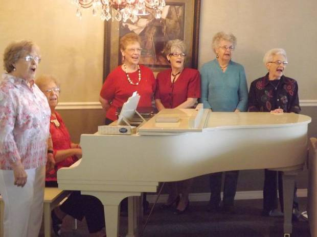 Members of Rural Neighbors OHCE celebrated their 100th birthday with song. (Chickasha Express-Star photo)