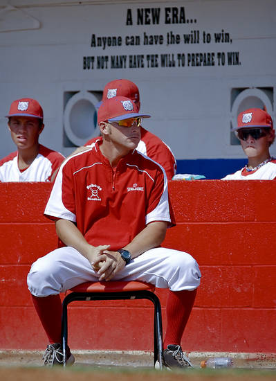 Former Major League Baseball player and current head coach of the Binger-Oney High School baseball team Reggie Willits looks on as the Bobcats play a game on Thursday, Sept. 20, 2012, in Binger, Okla. Photo by Chris Landsberger, The Oklahoman