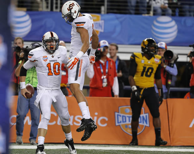 Oklahoma State's Clint Chelf (10) celebrates a touchdown beside Marcell Ateman (3) during the AT&T Cotton Bowl Classic Jan. 3. Photo by Bryan Terry, The Oklahoman