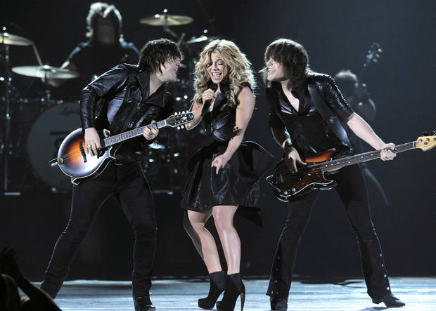 From left, Neil Perry, Kimberly Perry and Reid Perry, of musical group The Band Perry, perform at the 48th Annual Academy of Country Music Awards at the MGM Grand Garden Arena in Las Vegas on Sunday, April 7, 2013. (Photo by Chris Pizzello/Invision/AP) ORG XMIT: NVPM253