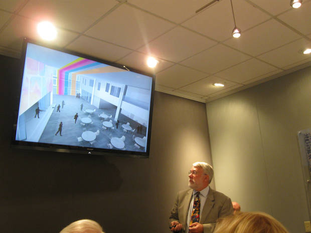 Kerry Leonard, with Cannon Design,  shows a proposed plan for a lobby in the new downtown elementary to the Oklahoma City Urban Renewal Authority. Photo by Steve Lackmeyer, The Oklahoman <strong></strong>