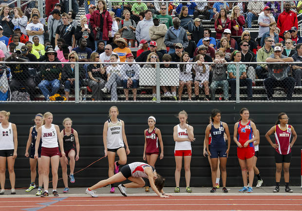 Members of the class 6A girls 4x800m relay wait their turn to run during the class 5A and 6A track state championships at Yukon High School on on Friday, May 10, 2013, in Yukon, Okla.Photo by Chris Landsberger, The Oklahoman