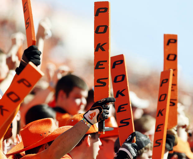 OSU fans raise their paddles during a college football game between Oklahoma State University (OSU) and Iowa State University (ISU) at Boone Pickens Stadium in Stillwater, Okla., Saturday, Oct. 20, 2012. Photo by Nate Billings, The Oklahoman