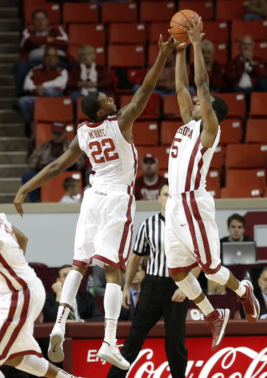 Oklahoma's Amath M'Baye (22) and Je'Lon Hornbeak (5) go up for a ball during a men's college basketball game between the University of Oklahoma and the University of Louisiana-Monroe at the Loyd Noble Center in Norman, Okla., Sunday, Nov. 11, 2012.  Photo by Garett Fisbeck, The Oklahoman