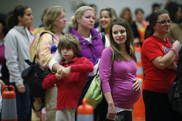 Nicole Andreacchio, second right, who is seven months pregnant waits in line to receive the swine flu vaccine in 2009 in Maple Glen, Pa. A large study released by the New England Journal of Medicine on Wednesday offers reassuring news for pregnant women worried about getting a flu shot. AP File Photo