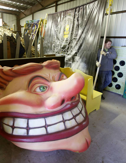 Graphic designer Jay Tracy brings a large painted display out of storage in preparation for Haunt the Zoo at the Oklahoma City Zoo. The annual event begins its five-day run Friday. Photo by Paul Hellstern, The Oklahoman <strong>PAUL HELLSTERN</strong>