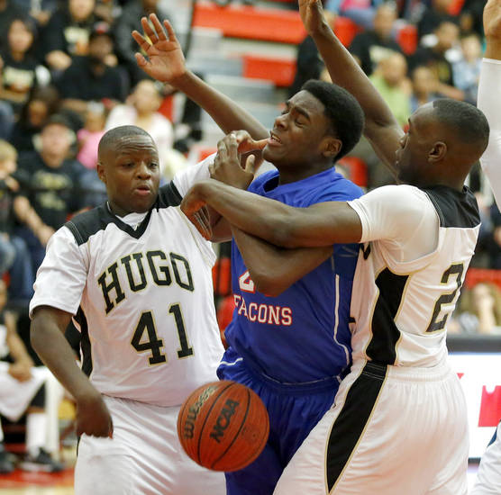 Millwood&#039;s Jamal Green-Gaskins gets caught between Hugo&#039;s C.J. Scott, left, and Jordan Stafford during a Class 3A boys state basketball tournament game between Hugo and Millwood at Yukon High School in Yukon, Okla., Thursday, March 7, 2013. Photo by Bryan Terry, The Oklahoman