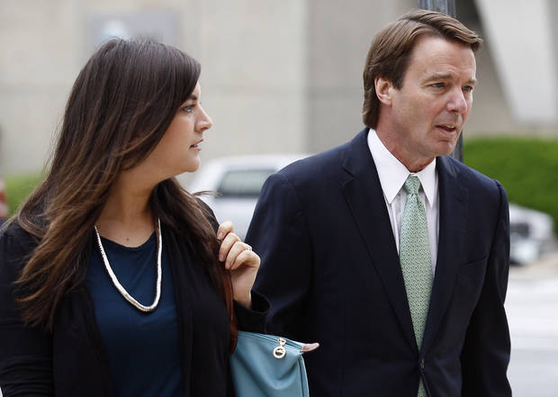 Former presidential candidate and Sen. John Edwards and his daughter Cate Edwards arrive at a federal courthouse in Greensboro, N.C., Wednesday, May 9, 2012. Edwards is accused of conspiring to secretly obtain more than $900,000 from two wealthy supporters to hide his extramarital affair with Rielle Hunter as well as her pregnancy. He has pleaded not guilty to six charges related to violations of campaign finance laws. (AP Photo/Gerry Broome)