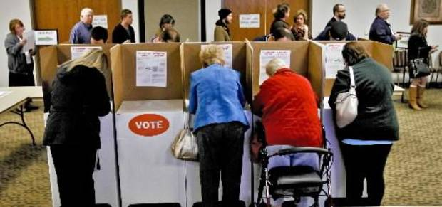 Voters cast votes during election day on Tuesday, Nov. 6, 2012, in Yukon, Oklahoma. Photo by Chris Landsberger, The Oklahoman