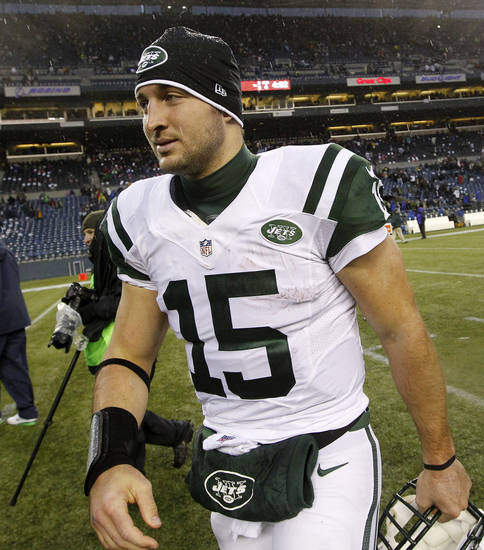 New York Jets quarterback Tim Tebow heads off the field after the Jets lost to the Seattle Seahawks in an NFL football game, Sunday, Nov. 11, 2012, in Seattle. The Seahawks won 28-7. Tebow ran four times for 14 yards, and was 3 of 3 passing for 8 yards. (AP Photo/Elaine Thompson)