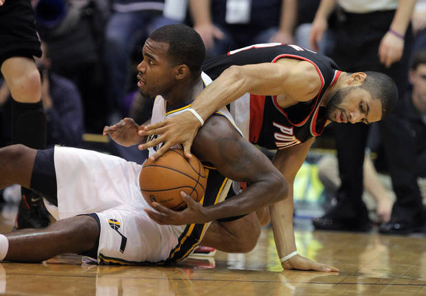 Utah Jazz forward Paul Millsap, left, works to keep control of a loose ball as Portland Trail Blazers forward Nicolas Batum, right, of France, tries to take it in the first half during an NBA basketball game on Friday, Feb. 1, 2013, in Salt Lake City. (AP Photo/Steve C. Wilson)