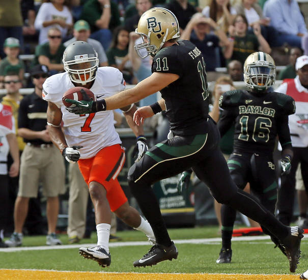 Baylor&#039;s Nick Florence (11) rushes for a touchdown past Oklahoma State&#039;s Shamiel Gary (7) in the second quarter during a college football game between the Oklahoma State University Cowboys (OSU) and the Baylor University Bears at Floyd Casey Stadium in Waco, Texas, Saturday, Dec. 1, 2012. Photo by Nate Billings, The Oklahoman