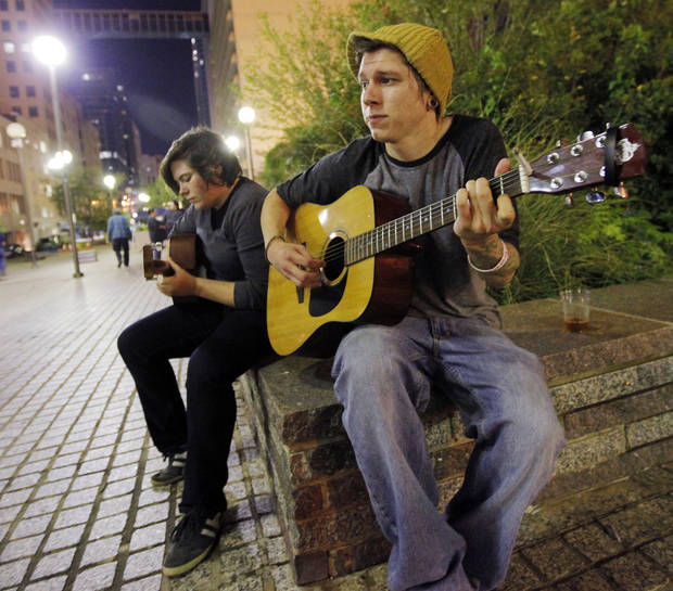 Christopher Hooks, right, and Hilary DeVries, play guitars together during Occupy OKC at Kerr Park in downtown Oklahoma City, Monday, Oct. 10, 2011. Photo by Nate Billings, The Oklahoman