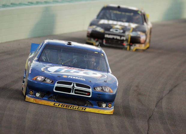 Brad Keselowski competes during the NASCAR Sprint Cup Series auto race at Homestead-Miami Speedway, Sunday, Nov. 18, 2012, in Homestead, Fla. (AP Photo/The Miami Herald, Andrew Uloza) MAGS OUT