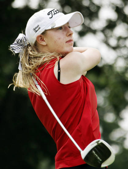 Hilldale's Courtney Cunningham hits a tee shot during the Class 4A girls state high school golf tournament at Lake Hefner in Oklahoma City, Wednesday, May 2, 2012. Photo by Nate Billings, The Oklahoman
