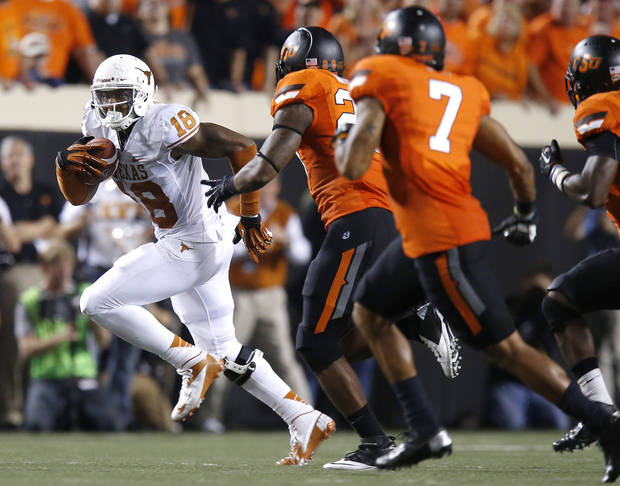 Texas' D.J. Grant (18) runs after a reception on a fourth-down play late in the college football game between Oklahoma State University (OSU) and the University of Texas (UT) at Boone Pickens Stadium in Stillwater, Okla., Saturday, Sept. 29, 2012. Oklahoma State lost 41-36. Photo by Bryan Terry, The Oklahoman