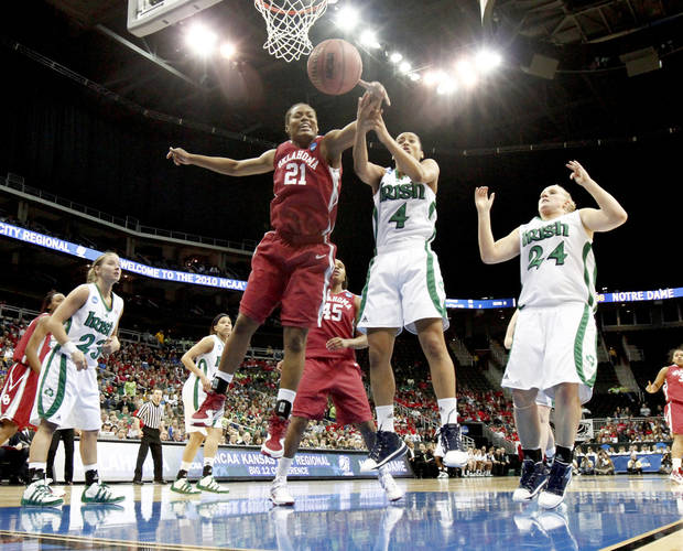 OU's Amanda Thompson goes for the ball beside Notre Dame's Skylar Diggins during the Sweet 16 round of the NCAA women's  basketball tournament in Kansas City, Mo., on Sunday, March 28, 2010. 