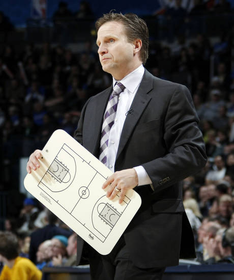 Oklahoma City head coach Scott Brooks stands during a timeout in the NBA basketball game between the Orlando Magic and Oklahoma City Thunder in Oklahoma City, Thursday, January 13, 2011. Photo by Nate Billings, The Oklahoman