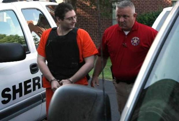 Kevin Sweat (left) is escorted by a sheriff into the Okfuskee County Courthouse, in Okemah, before his preliminary hearing, on Tuesday, May 22, 2012. CORY YOUNG/Tulsa World 
