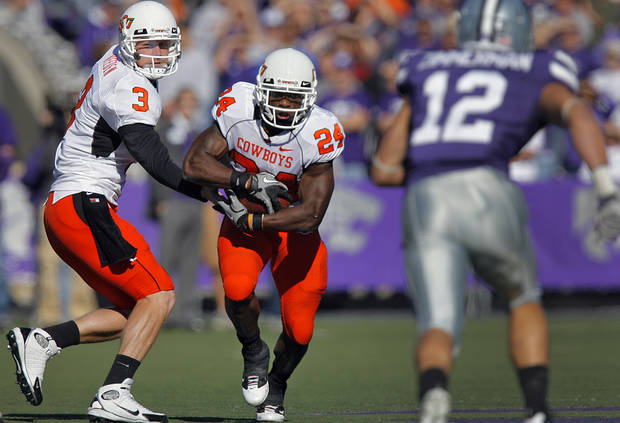Oklahoma State's Brandon Weeden (3) hands the ball off to Kendall Hunter (24) in front of Kansas State's Ty Zimmerman (12) during the first half of the college football game between the Oklahoma State University Cowboys (OSU) and the Kansas State University Wildcats (KSU) on Saturday, Oct. 30, 2010, in Manhattan, Kan.   Photo by Chris Landsberger, The Oklahoman