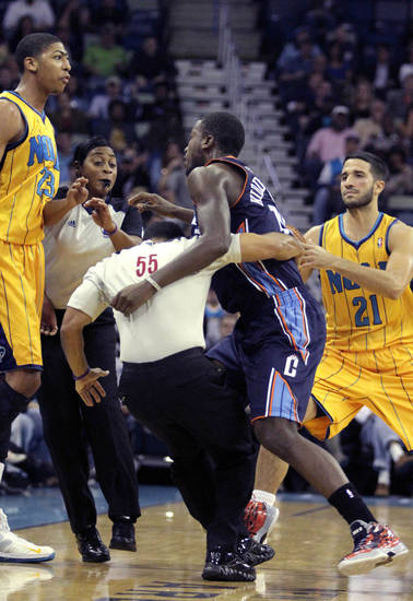 Charlotte Bobcats small forward Michael Kidd-Gilchrist (14) scuffles towards New Orleans Hornets power forward Anthony Davis (23) as referees intervene in the first half of an NBA basketball game in New Orleans, Friday, Nov. 9, 2012. (AP Photo/The Times-Picayune, Maura Friedman) BATON ROUGE ADVOCATE OUT; MAGAZINES OUT; NO SALES; USA TODAY OUT