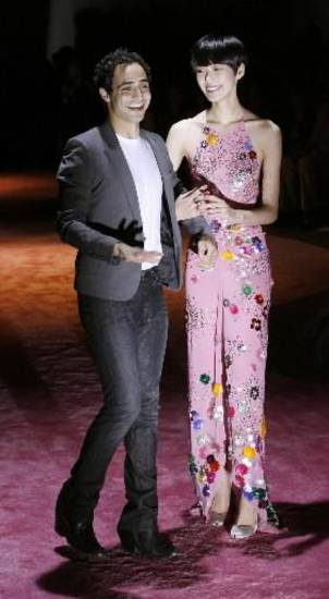 Zac Posen and a model at his spring 2010 runway show. AP PHOTO