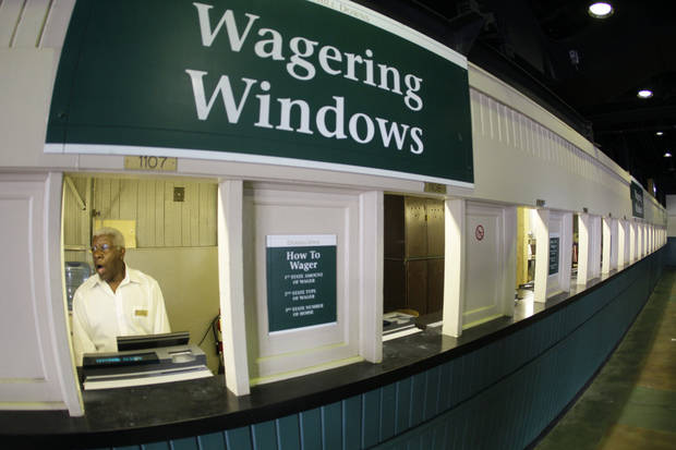 Herman Thomas waits for patrons at his wagering window before the 138th Kentucky Derby horse race at Churchill Downs Saturday, May 5, 2012, in Louisville, Ky. (AP Photo/Mark Humphrey) ORG XMIT: DBY106