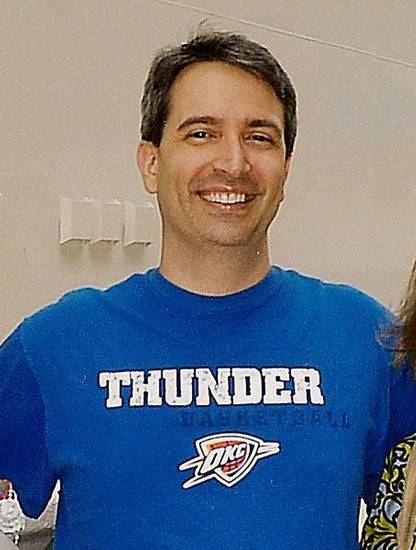The Rev. Ronnie Fields shows his support of the Oklahoma City Thunder during a recent trip to Cozumel, Mexico, by wearing a team shirt. Photo provided