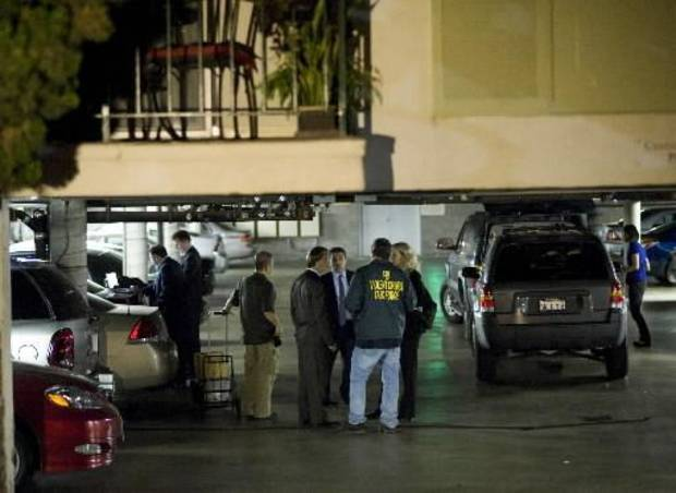 "FBI agents stand in the ground floor parking garage of the apartment building in Santa Monica, Calif., where fugitive crime boss James ""Whitey"" Bulger and his longtime companion Catherine Greig were arrested Wednesday evening, June 22, 2011. Bulger, a notorious Boston gangster on the FBI's ""Ten Most Wanted"" list for his alleged role in 19 murders, was captured Wednesday near Los Angeles after living on the run for 16 years, authorities said. (AP Photo/David Zentz)"