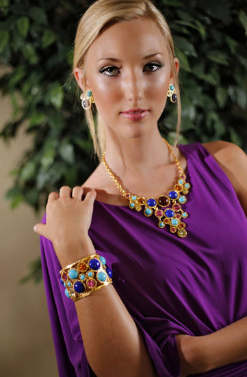 Kenneth Jay Lane multicolor necklace, earrings and bracelet with Gianni Bini one-shoulder shirred dress, available at Dillard's, Penn Square. Makeup by Lilly Stone, Sooo Lilly Cosmetics. Photo by Chris Landsberger, The Oklahoman.   <strong>CHRIS LANDSBERGER</strong>
