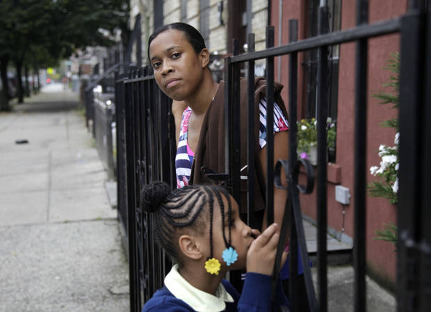 Olgita Blackwood, top, waits for her son to return home from school with her daughter, Malaysia Blackwood, 7, at their apartment in the Drew House in New York, Wednesday, Oct. 3, 2012. The program, called Drew House, is one of a kind in the nation, where mothers arrested on felonies can live with their children, instead of in prison. The program has been lauded as a success that should be replicated around the country, but the small house is already full, and without additional funding and space, it can�t grow. (AP Photo/Seth Wenig)