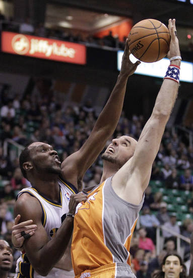 Utah Jazz center Al Jefferson, left, blocks the shot of Phoenix Suns center Marcin Gortat, right, of Poland, in the first quarter during an NBA basketball game on Saturday, Nov. 10, 2012, in Salt Lake City. (AP Photo/Rick Bowmer)