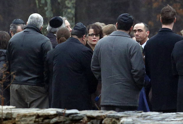 Veronique Pozner, center, walks near people at B&#039;nai Israel Cemetery during burial services for her 6-year-old son Noah Pozner, Monday, Dec. 17, 2012, in Monroe, Conn. Noah Pozner was killed when Adam Lanza walked into Sandy Hook Elementary School in Newtown, Conn., Friday and opened fire, killing 26 people, including 20 children, before killing himself. (AP Photo/Julio Cortez) ORG XMIT: CTJC130