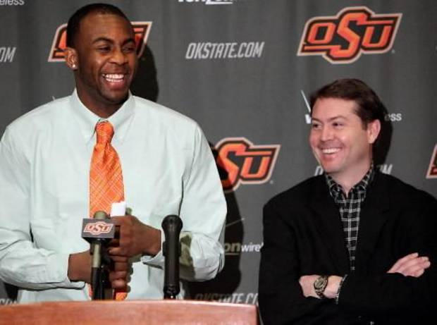 Oklahoma State basketball player James Anderson and Head Coach Travis Ford reacts to a joke by Travis Ford during a question at a press conference at Gallagher-Iba Arena on the OSU campus in Stillwater, Okla., on Monday, March 22, 2010. Anderson announced that he will enter the next NBA draft. Photo by  John   Clanton, The Oklahoman