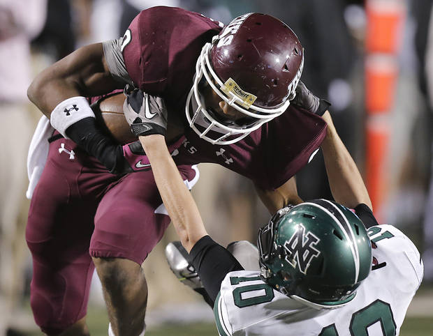 Jenks' Jordan Smallwood (2) sheds off Norman North's Carter Klein (10) to score a touchdown during the Class 6A Oklahoma state championship football game between Norman North High School and Jenks High School at Boone Pickens Stadium on Friday, Nov. 30, 2012, in Stillwater, Okla.   Photo by Chris Landsberger, The Oklahoman